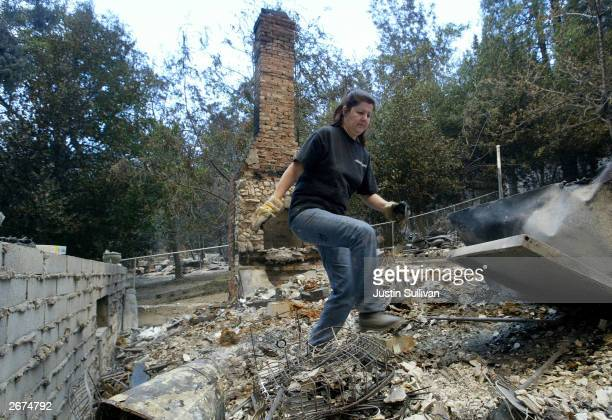 Laura Gomez of Pomona California looks through the rubble of her sisters burnt out house October 28 2003 in Waterman Canyon California Wildfires...