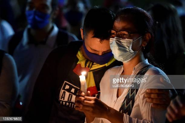 Laura Guerrero , mother of Nicolas Guerrero, who was killed during clashes with riot police at a protest against a tax reform bill, cries next to her...