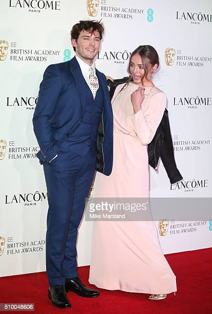 Laura Haddock and Sam Claflin attend the Lancome BAFTA nominees party at Kensington Palace on February 13 2016 in London England