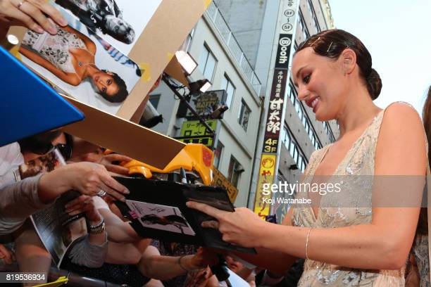 Laura Haddock signs autograph for fans at the Japanese premiere of 'Transformers The Last Knight' at TOHO Cinemas Shinjuku on July 20 2017 in Tokyo...