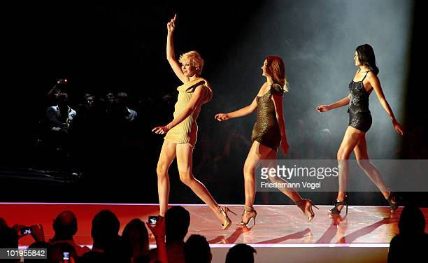 Laura Hanna and Alisar perform during the PRO7 TV show 'Germany's Next Topmodel Final' at the Lanxess Arena on June 10 2010 in Cologne Germany