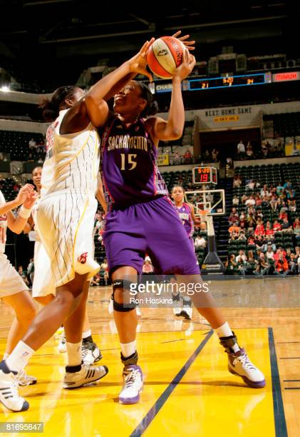 Laura Harper of the Sacramento Monarchs battles Ebony Hoffman of the Indiana Fever at Conseco Fieldhouse June 24 2008 in Indianapolis Indiana NOTE TO...