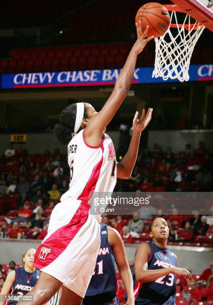 Laura Harper tips in a basket for Maryland in the game against Arizona at Comcast Center on the campus of the University of Maryland in College Park...