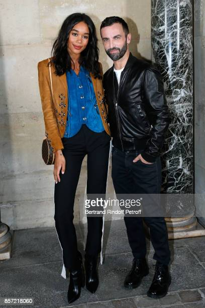 Laura Harrier and stylist Nicolas Ghesquiere pose after the Louis Vuitton show as part of the Paris Fashion Week Womenswear Spring/Summer 2018 on...