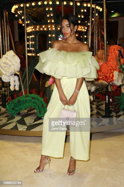 Laura Harrier poses infront of artwork by Raul De Nieves presented by Bvlgari Art Production Fund during Art Basel Miami Beach 2018 at Faena Hotel on...