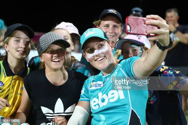 Laura Harris of the Heat poses with fans after the Women's Big Bash League match between the Brisbane Heat and the Melbourne Stars on January 13 2018...
