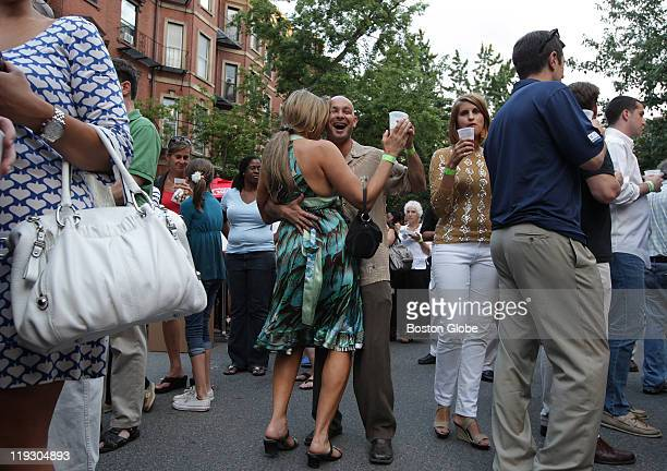 Laura Hartung of Natick and Mario Goncalves of Worcester found themselves in an impromptu dance as they waited in line for food during the 36th...