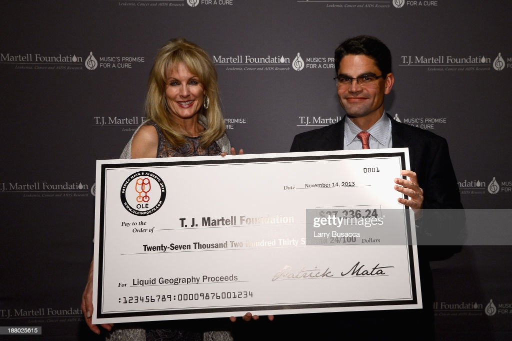 Laura Heatherly, CEO of the T.J. Martell Foundation and Honoree Kevin Mata attend T.J. Martell Foundation's Annual World Tour of Wine Dinner at The Angel Orensanz Foundation on November 14, 2013 in New York City.