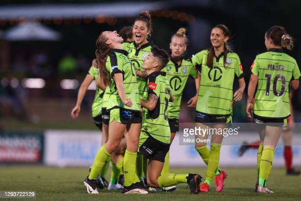 Laura Hughes of Canberra United celebrates with teammates after scoring a goal during the round one W-League match between Canberra United and...
