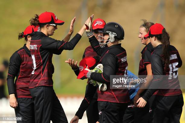 Laura Hughes of Canterbury celebrates with Amy Satterthwaite after taking the wicket of Amelia Kerr of Wellington during the Hallyburton Johnstone...