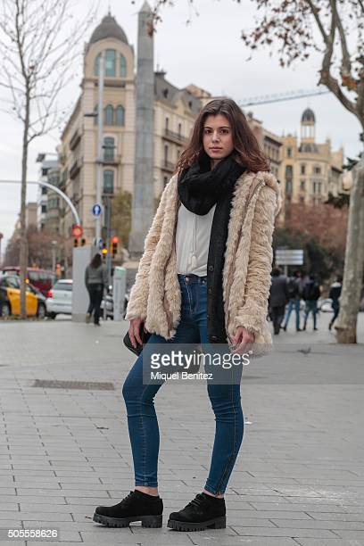 Laura is wearing a Bershka coat blouse and hat Doble Agent cardigan Urban Outfitter jeans Alpes shoes Stradivarius handbag and scarf on January 18...
