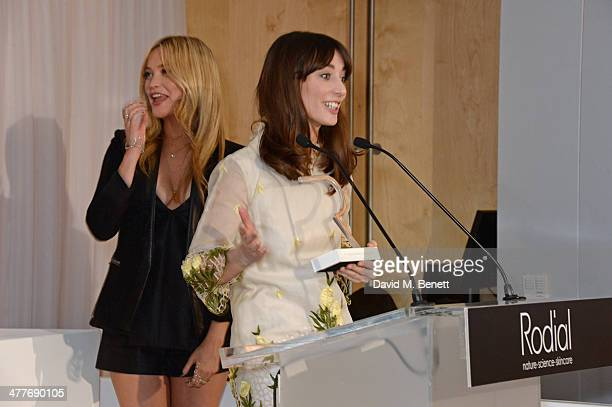 Laura Jackson winner of the Best Newcomer award speaks as host Laura Whitmore looks on at the 5th annual Rodial Beautiful Awards to celebrate women...
