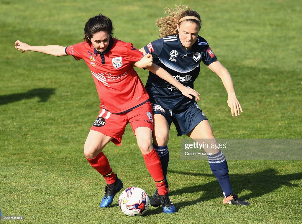 Laura Johns of Adelaide United and Kristen McNabb of the Victory compete for the ball during the round seven W-League match between the Melbourne Victory and Adelaide United at Lakeside Stadium on December 9, 2017 in Melbourne, Australia.