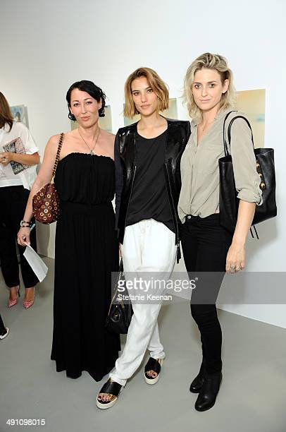 Laura Jonch Arina Trinneer and Emily Armstrong attend the grand opening of De Re Gallery on May 15 2014 in West Hollywood CA