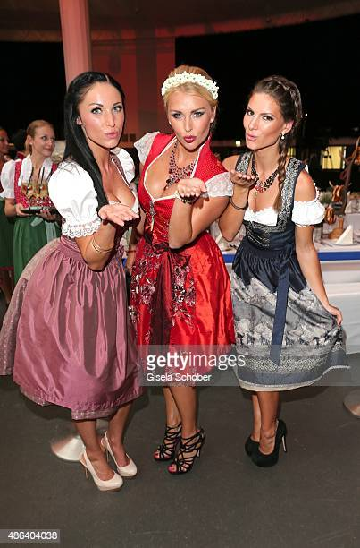 Laura Kaiser Denise Cotte and Verena Stangl during the Angermaier TrachtenNacht 2015 at Postpalast in Munich on September 3 2015 in Munich Germany