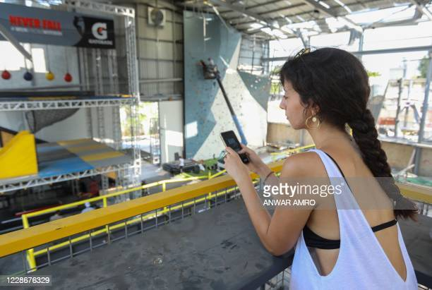 Laura Karam checks her phone inside the damaged Flyp centre in the Lebanese capital beirut on September 17, 2020. - In the Karantina neighbourhood,...