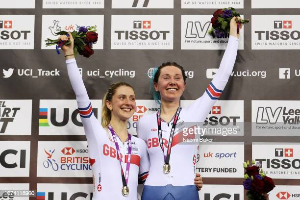 Laura Kenny and Katie Archibald of Great Britain celebrate during the victory ceremony after they win the gold medal for the Women's Madison...