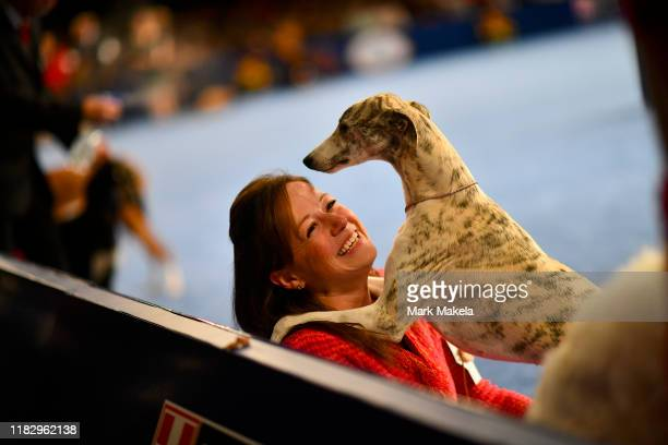 Laura Kieffer shares a laugh with Lizzie a Whippet during the National Dog Show held at the Greater Philadelphia Expo Center on November 16 2019 in...