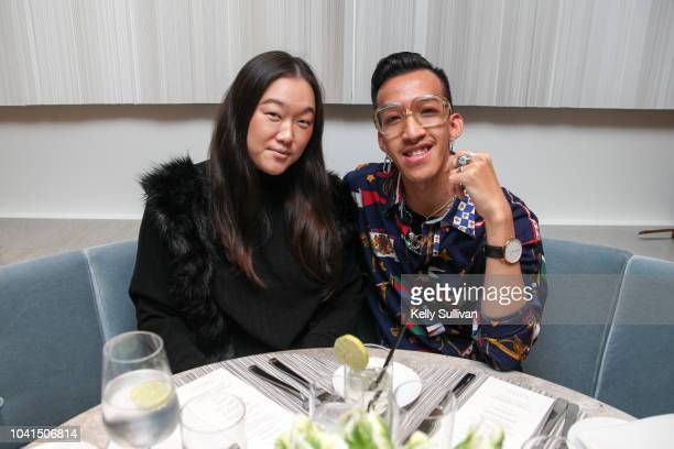 Laura Kim and Brandon Tran pose for a photo at the opening of Freds at Barneys New York San Francisco on September 26 2018 in San Francisco California