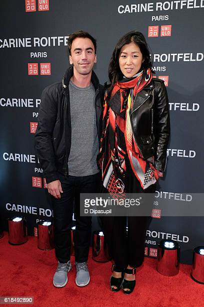 Laura Kim and guest attend the UNIQLO Fall/Winter 2016 Carine Roitfeld Collection Launch at UNIQLO on October 26 2016 in New York City