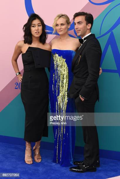 Laura Kim Diane Kruger and Fernando Garcia attend the 2017 CFDA Fashion Awards at Hammerstein Ballroom on June 5 2017 in New York City