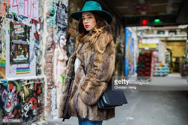 Laura Kokinova wearing a vintage coat Asos pants Filippo Catarzi hat otherstories bag Sweater Adidas during the MercedesBenz Fashion Week Berlin...