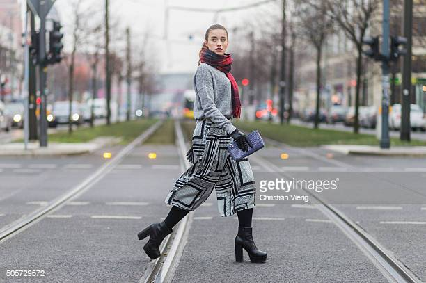 Laura Kokinova wearing COS sweater Gina Tricot pants Faith shoes HM scarf Estee Lauder clutch otherstories gloves during the MercedesBenz Fashion...