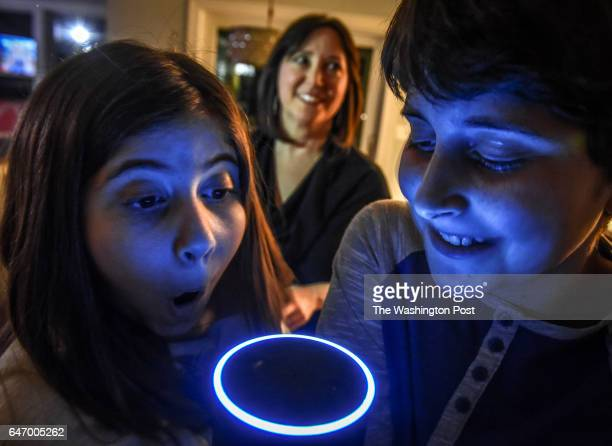Laura Labovich background and her children Asher right and Emerson left with the family Alexa an artificial intelligence device on January 2017 in...