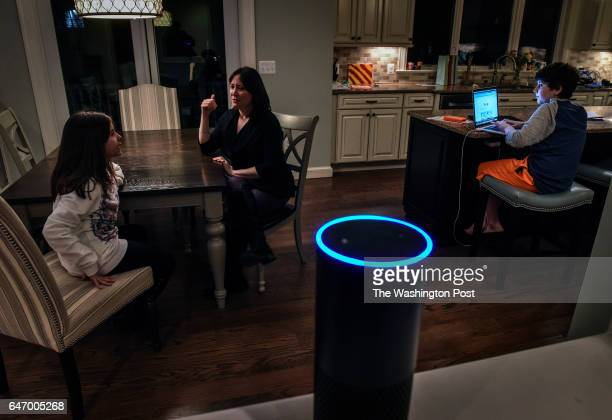 Laura Labovich center and her children Asher right and Emerson left with the family Alexa foreground an artificial intelligence device on January...