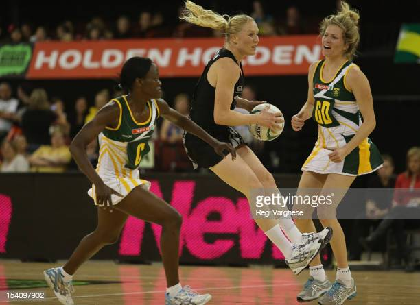 Laura Langman of New Zealand picks a pass during the 2012 Quad Series match between the New Zealand Silver Ferns and South Africa at Adelaide...