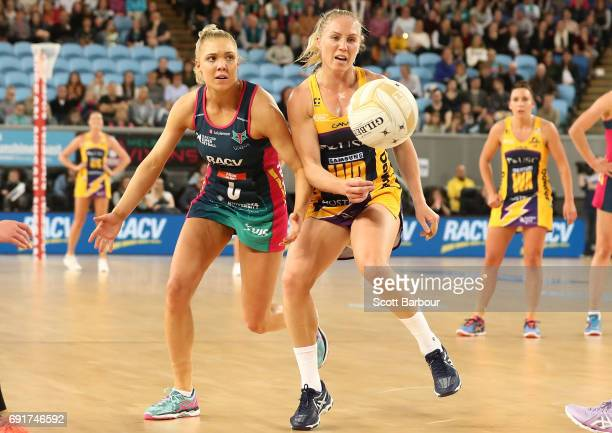Laura Langman of the Lightning and Elizabeth Watson of the Vixens compete for the ball during the Super Netball Major Semi Final match between the...
