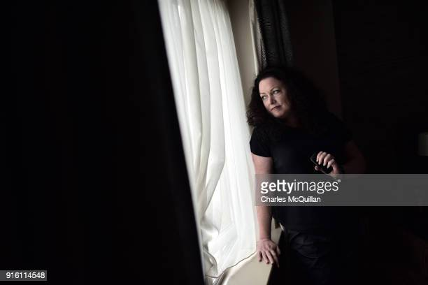 Laura Lee looks out of a window in her hotel room in a previously  unreleased photograph bdcecef7d