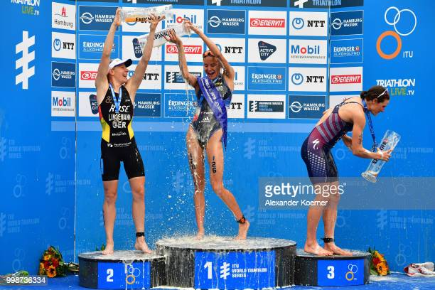 Laura Lindemann of Germany Cassandre Beaugrand of France and Katie Zaferes of the United States celebrate during the ITU World Triathlon Elite women...