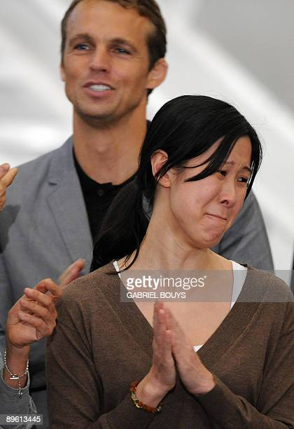 Laura Ling is welcomed by her husband Iain Clayton she and fellow journalist Euna Lee arrived from North Korea at the airport in Burbank, California...
