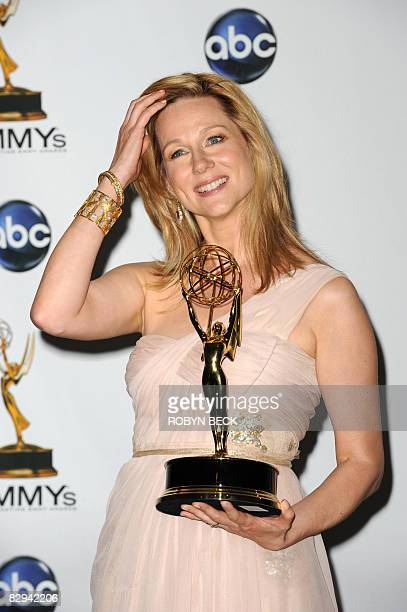 Laura Linney holds the award for outstanding lead actress in a miniseries or a movie for her work on 'John Adams' in the press room at the 60th...