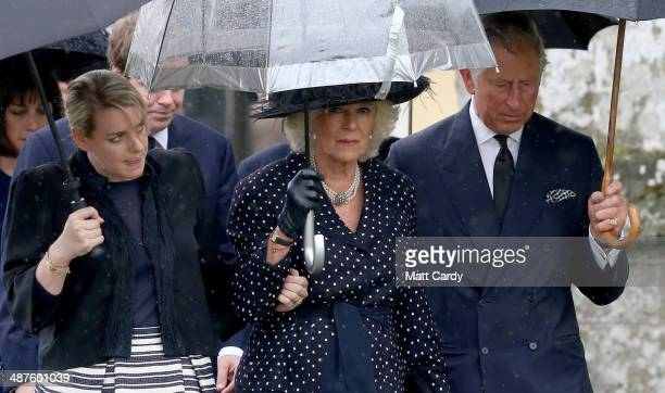 Laura Lopes Camilla Duchess of Cornwall and Prince Charles Prince of Wales arrive for Mark Shands funeral at Holy Trinity Church in Stourpaine on May...