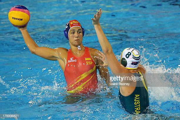 Laura Lopez of Spain controls the ball against Glencora McGhie of Australia during the Women's Water Polo Gold Medal Match between Australia and...