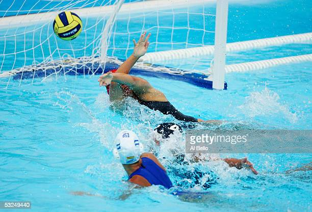 Laura Lopez of Spain gets the tying goal past goalkeeper Jaime Hipp of the US in the preliminary match during the XI FINA World Championships on July...
