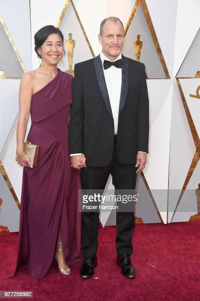 Laura Louie and Woody Harrelson attend the 90th Annual Academy Awards at Hollywood Highland Center on March 4 2018 in Hollywood California