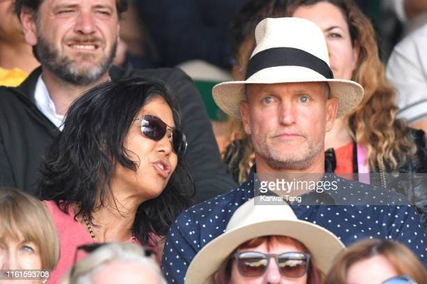 Laura Louie and Woody Harrelson on Centre Court during day eleven of the Wimbledon Tennis Championships at All England Lawn Tennis and Croquet Club...