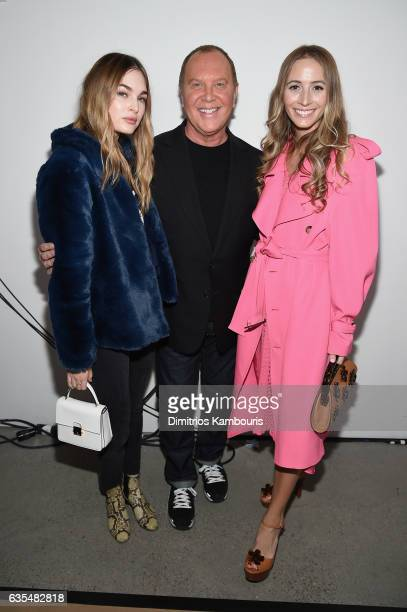 Laura Love, Michael Kors, and Harley Viera-Newton attend the Michael Kors Collection Fall 2017 runway show at Spring Studios on February 15, 2017 in...