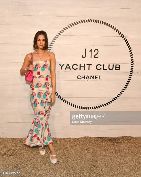 Laura Love wears a long ecru silk printed muslin dress, look 36, from the Spring-Summer 2019 Ready-to-Wear collection, CHANEL shoes, bag &...