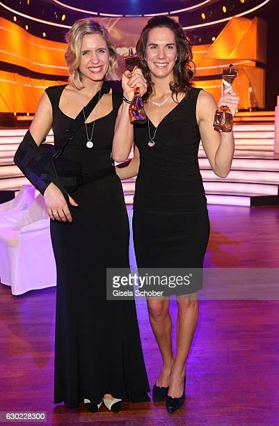 Laura Ludwig and her beach volleyball team mate Kira Walkenhorst, Olympic gold medalist, champion with award during the 'Sportler des Jahres 2016'...