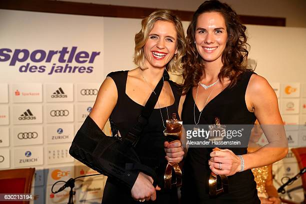 Laura Ludwig and her team mate Kira Walkenhorst poses with her Sportler des Jahres 2016 award during the Sportler des Jahres 2016 gala at Kurhaus...