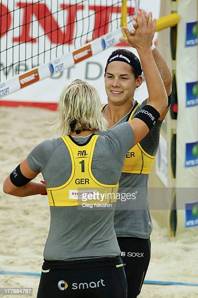 Laura Ludwig and Kira Walkenhorst of Germany celebrate a point during World Tour Moscow Grand Slam on August 25 2013 in Moscow, Russia.