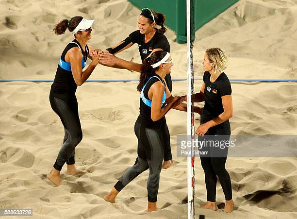 Laura Ludwig and Kira Walkenhorst of Germany celebrate after defeating Laura Giombini and Marta Menegatti of Italy in the Women's Preliminary Pool D...