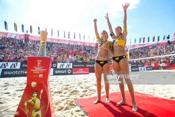 Laura Ludwig and Kira Walkenhorst of Germany celebrate after winning the gold medal match during Day 9 of the FIVB Beach Volleyball World...