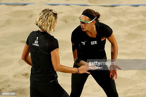 Laura Ludwig and Kira Walkenhorst of Germany celebrate as they take on Marta Menegatti and Laura Giombini of Italy during the Women's Preliminary...