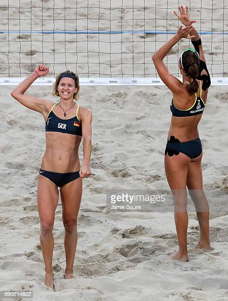 Laura Ludwig and Kira Walkenhorst of Germany celebrate beating Larissa Franca Maestrini and Talita Rocha of Brazil during the beach volleyball...