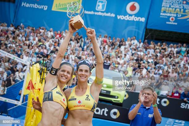 Laura Ludwig and Kira Walkenhorst of Germany celebrate gold medal at the Swatch Beach Volleyball FIVB World Tour Finals on August 26, 2017 in...